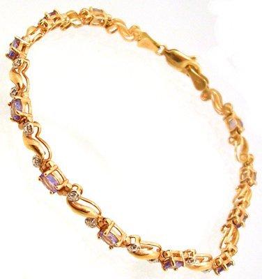 1305: 14KY 2cttw Tanzanite Oval Diamond Bracelet