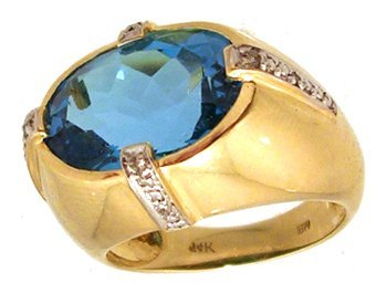 1855: 14KY 8ct Electric Blue Topaz oval .06 dia ring
