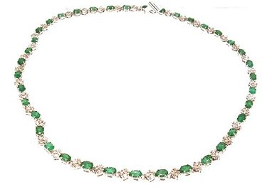 1913: 14WG 16.31ct Emerald Oval 3.61ct Dia Bagg Rd Neck
