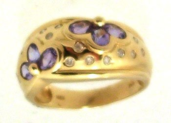 1102: 14KY 1.09ct Tanzanite Oval .26ct Dia Floral Band