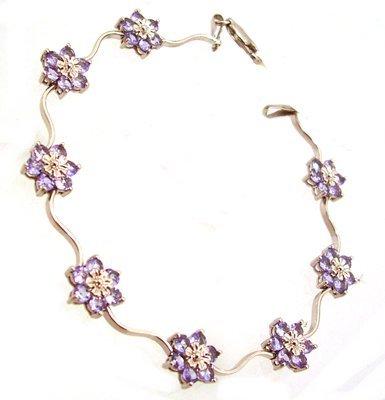 1308: 10KW 3.25cttw Tanzanite Flower Bracelet