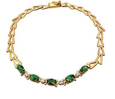 1807: 10kt .70cttw Emerald Oval Dia V line bracelet 7.2