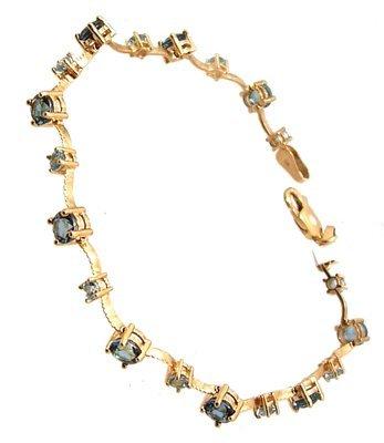 1830: 10KY 2cttw Blue Topaz Rd wave Bracelet