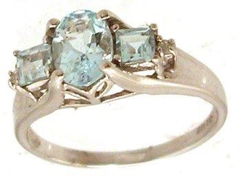 806: 10KW .90cttw Aquamarine Oval Princess Dia 3 stone