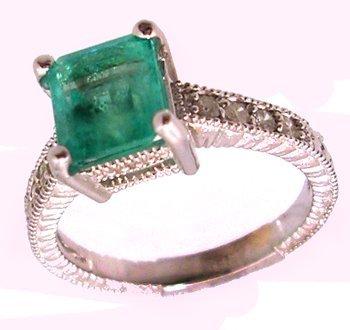 1107: 18KW 1.45ct Emerald Ecut .25cttw Diamond Ring