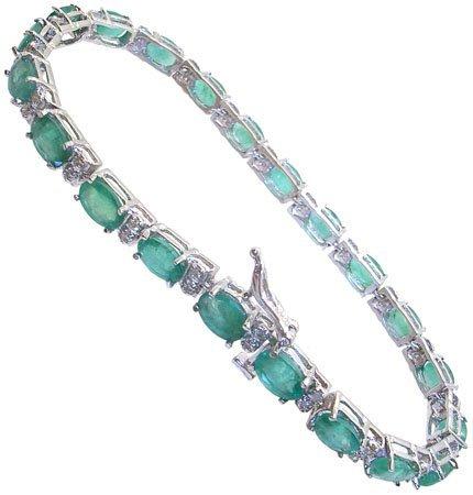 1109: 14KW 9.18cttw SI2 Emerald .48ct Dia bracelet APP$