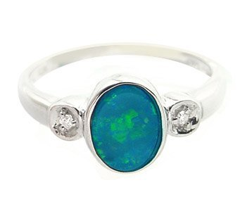 20: WG .65ct Boulder opal bezel dblt diamond ring