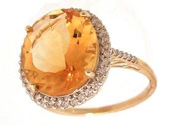 1104: 14KY 8ct Citrine oval 3/8cttw diamond ring