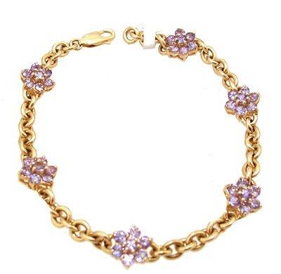 1114: 14KY 3cttw Tanzanite flower link bracelet