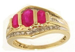 1431: 10KY 1.17ct Ruby .20cttw Diamond three Stone Ring