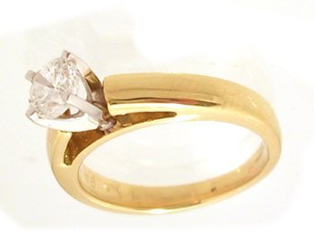 1114: 18KY .71ct Diamond Rd Solitaire Ring