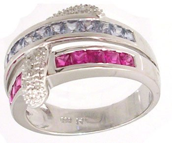 2101: 14KW 1.31ct Sapphire Blue Pink Channel .06ct Dia