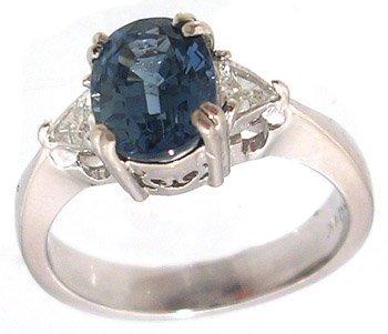 2102: 14KW 1.70ct Oval Blue Saph .30cttw Diamond Ring
