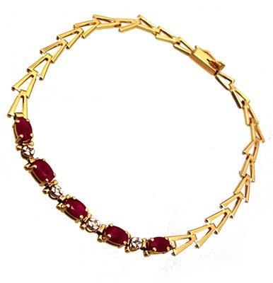 5110: 10kt .70cttw Ruby Oval Dia V line bracelet