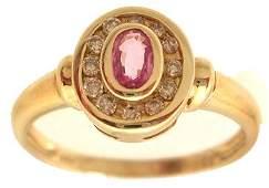 3100: 14KY .15ct Pink Sapphire Oval Diamond Bezel Ring
