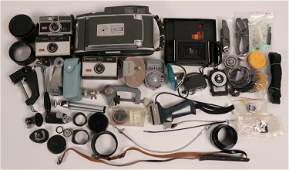 Box of Antique cameras and vintage equipment  112347