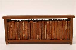 Mini books in wooden frame [131828]