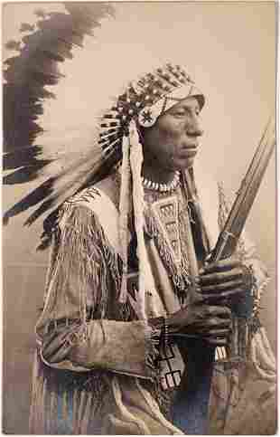 Native American Chief w/ Rifle Real Photo Postcard
