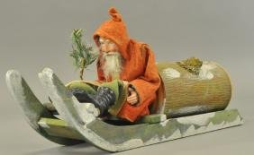 SANTA ON SLIEGH WITH GIANT LOG CANDY CONTAINER