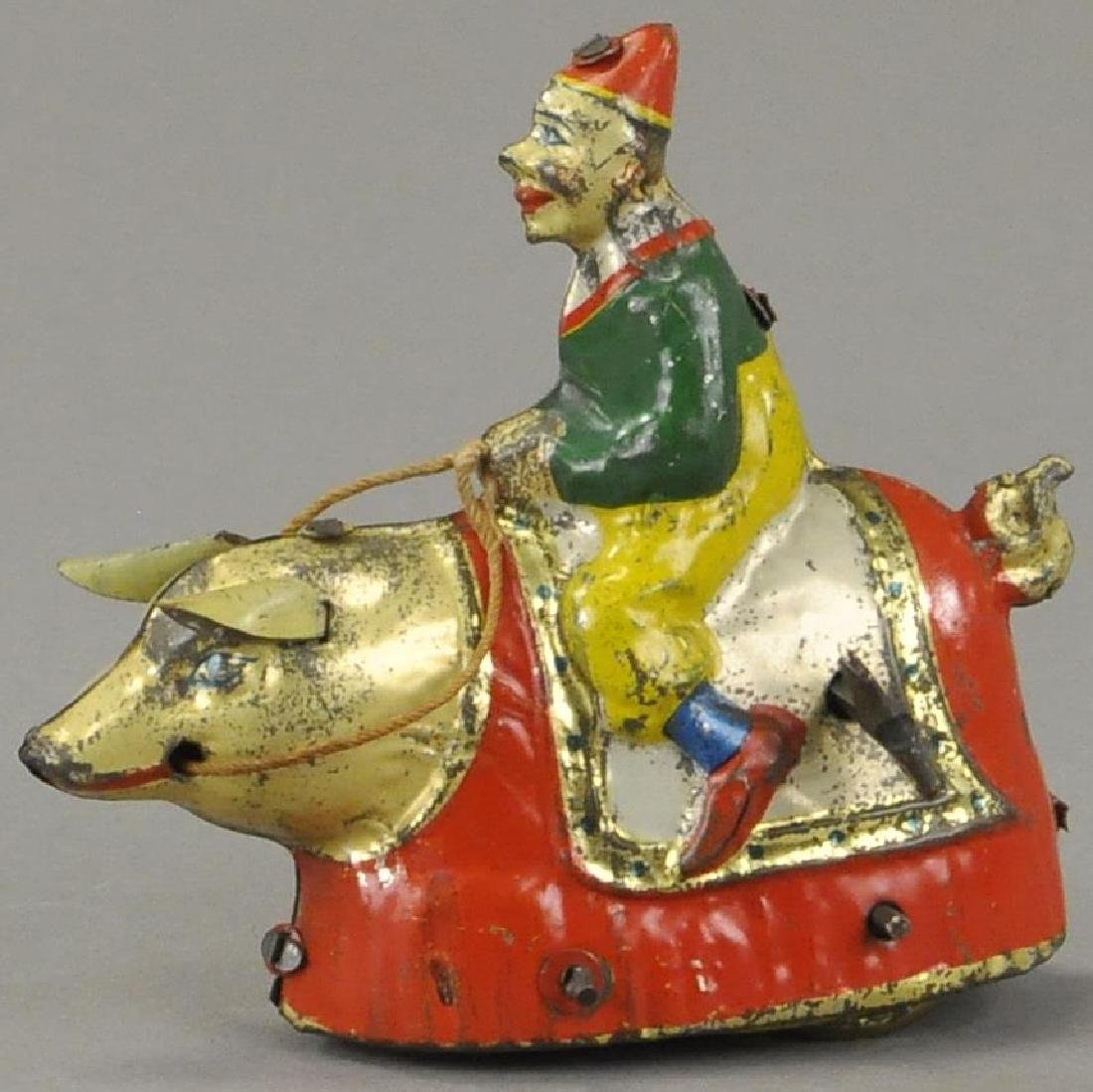 LITHOGRAPHED CLOWN RIDING PIG