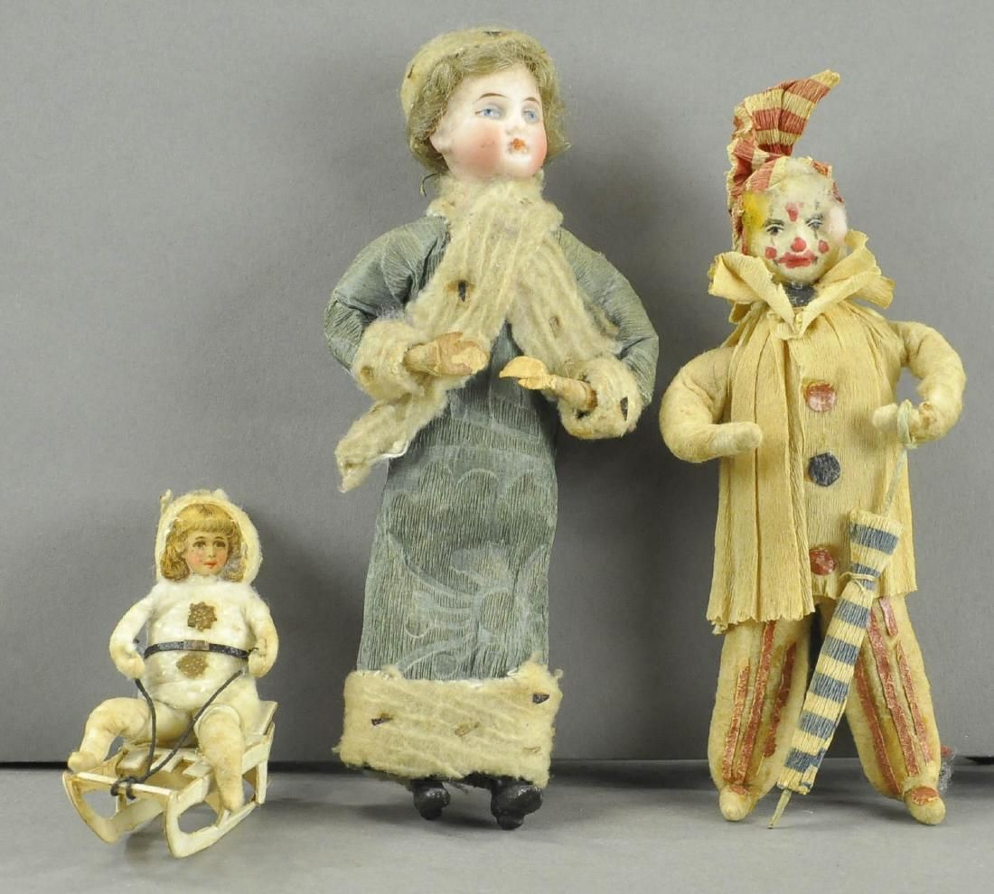 BISQUE HEAD LADY, CLOWN & CHILD ON SLED ORNAMENTS