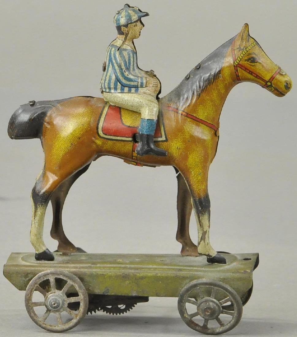 JOCKEY ON HORSE WIND UP TOY