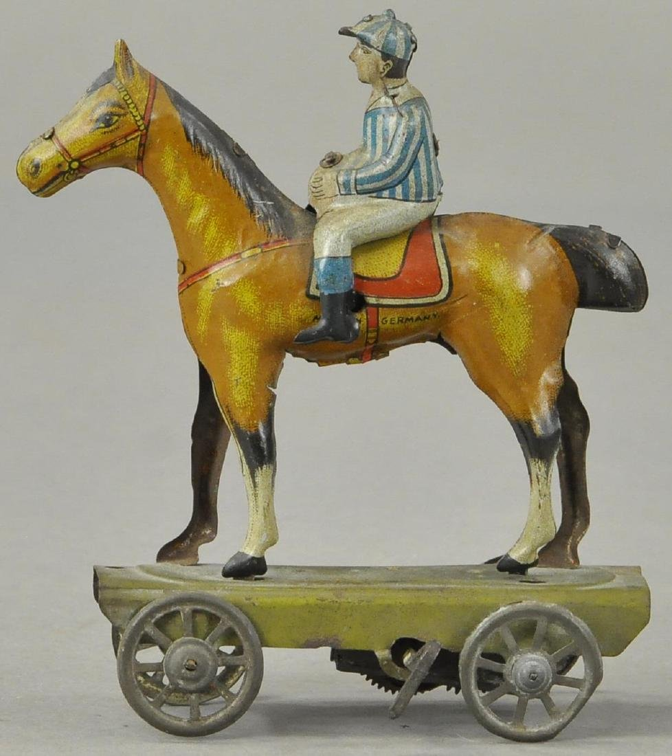 JOCKEY ON HORSE WIND UP TOY - 2