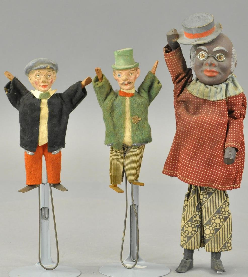 THREE GERMAN COMPOSITION SQUEEZE TOYS