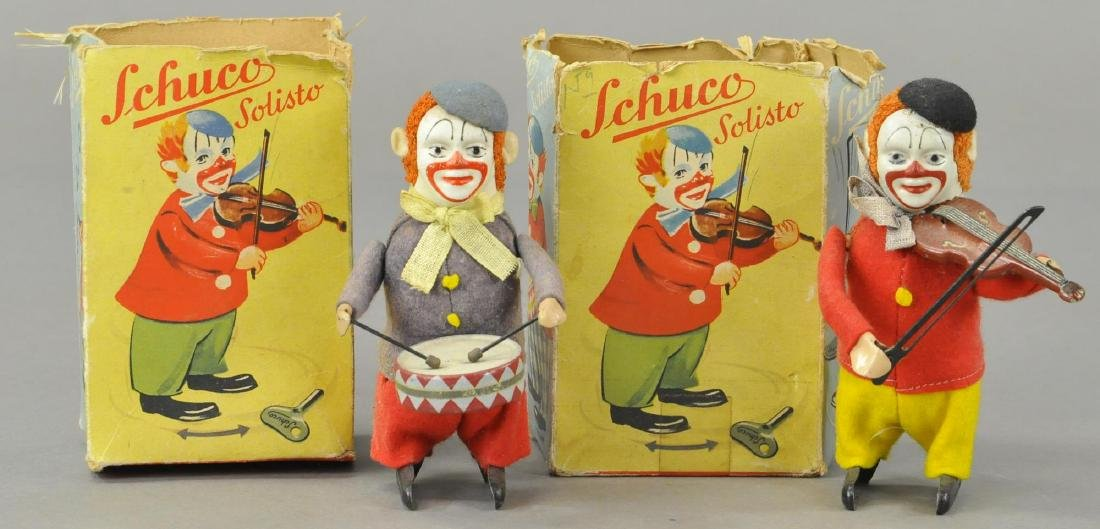 TWO BOXED SCHUCO CLOWN MUSICIANS