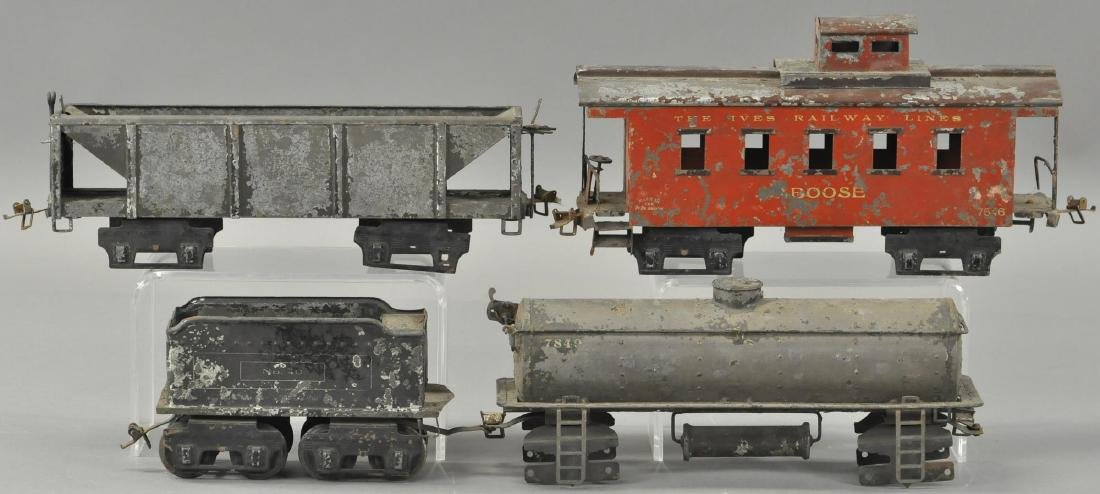 LOT OF FOUR IVES FREIGHT CARS AND TENDER