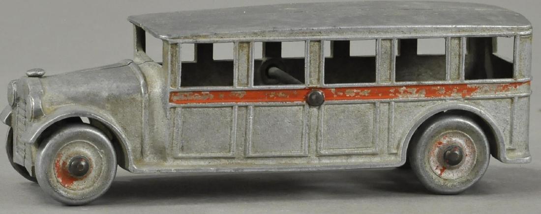 ALUMINUM DENT FIVE WINDOW BUS