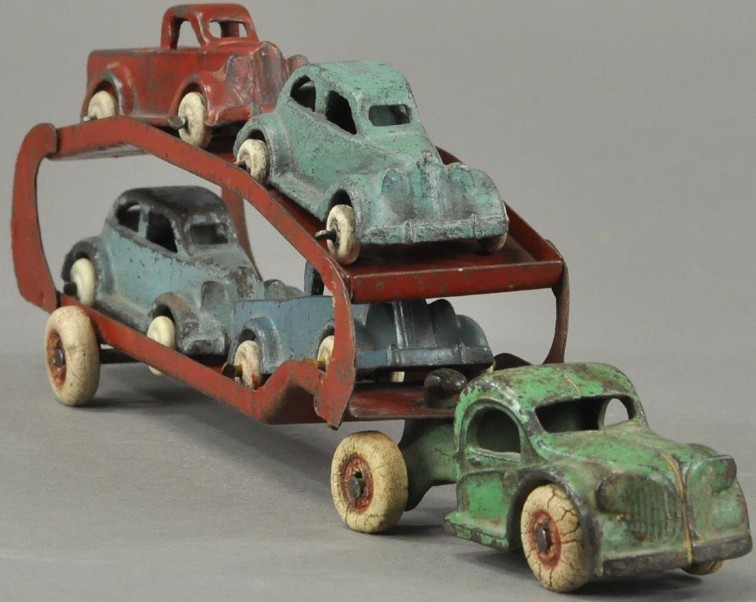 ARCADE CAR HAULER WITH FOUR CARS