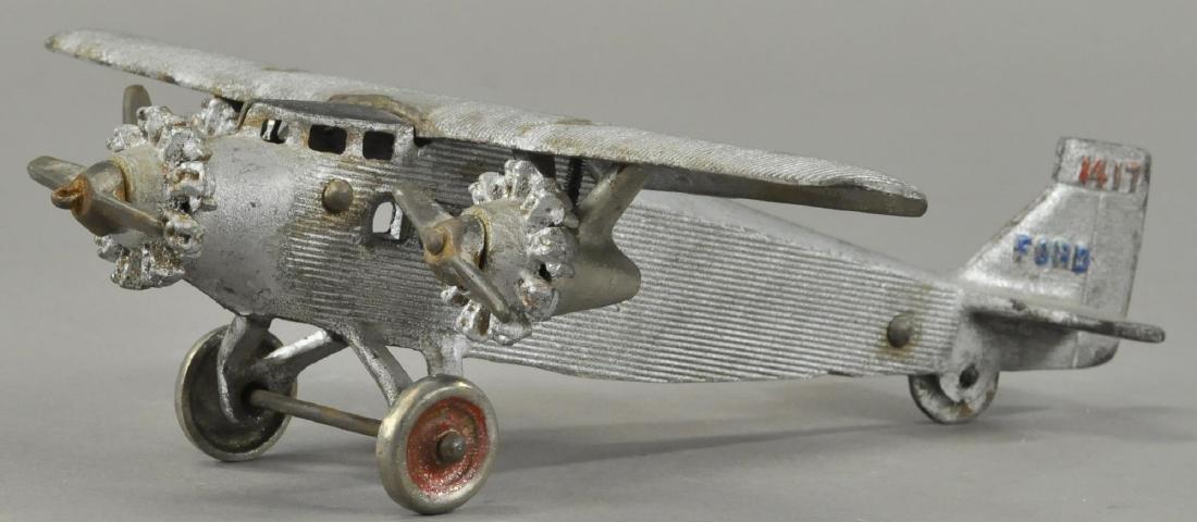 DENT FORD TRI-MOTOR AIRPLANE