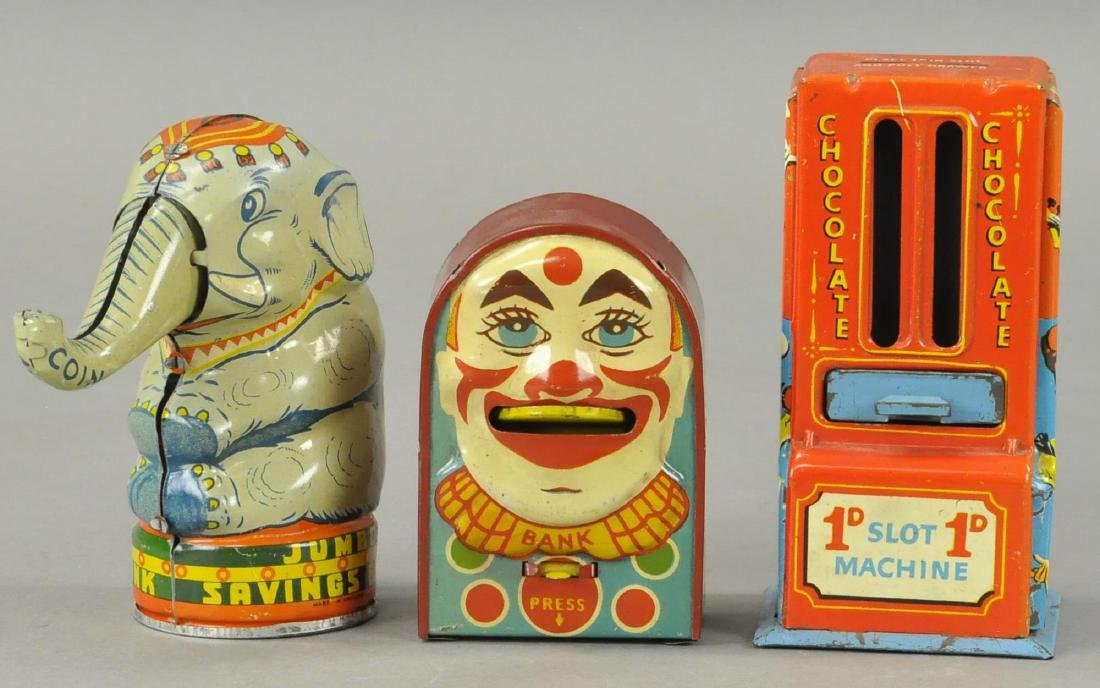THREE ENGLISH TIN PIGGY BANKS