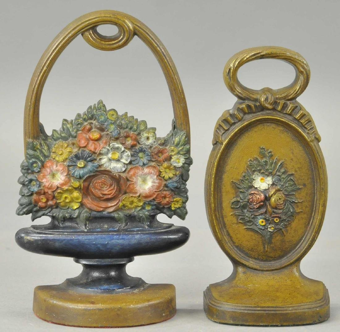 PAIR OF B&H FLOWER DOORSTOPS