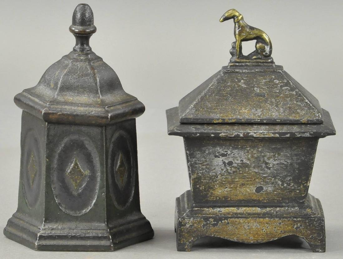 TWO CAST IRON TOBACCO HOLDERS