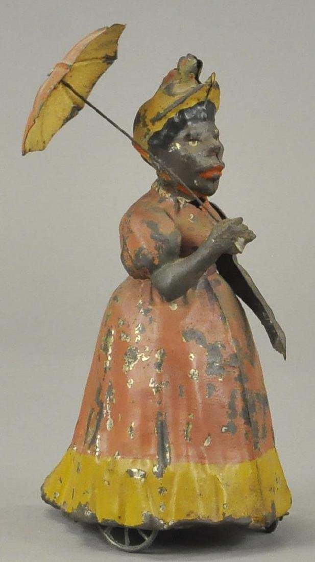 GERMAN TIN BLACK WOMAN W/ UMBRELLA
