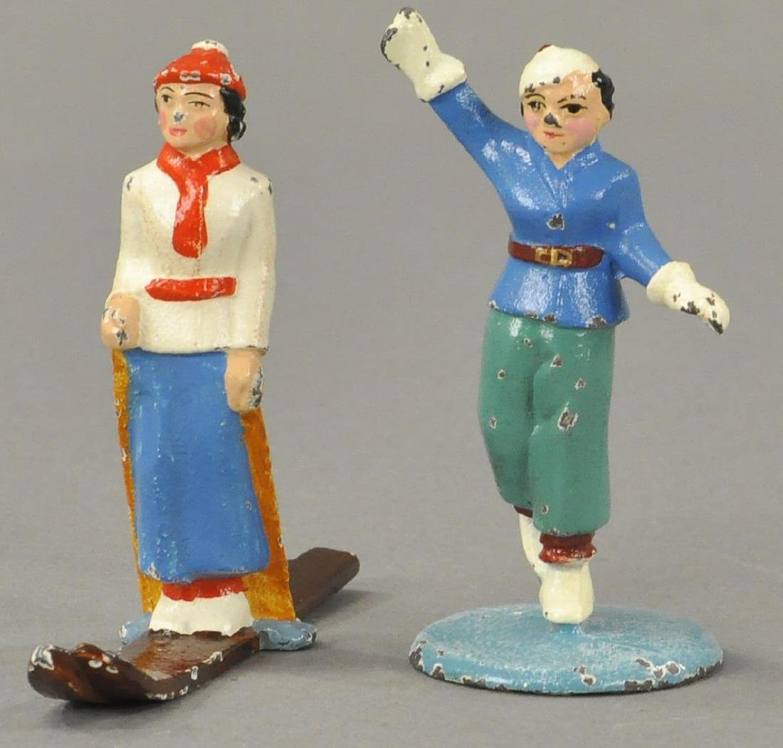 HUBLEY SKATER AND SKIER PAPERWEIGHTS