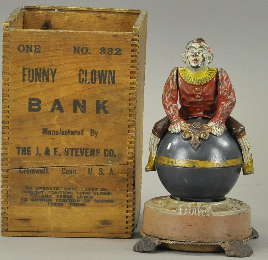 BOXED CLOWN ON GLOBE MECHANICAL BANK