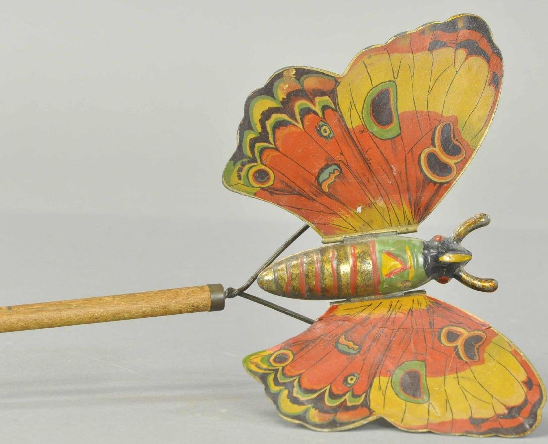 ARTICULATED BUTTERFLY PUSH TOY