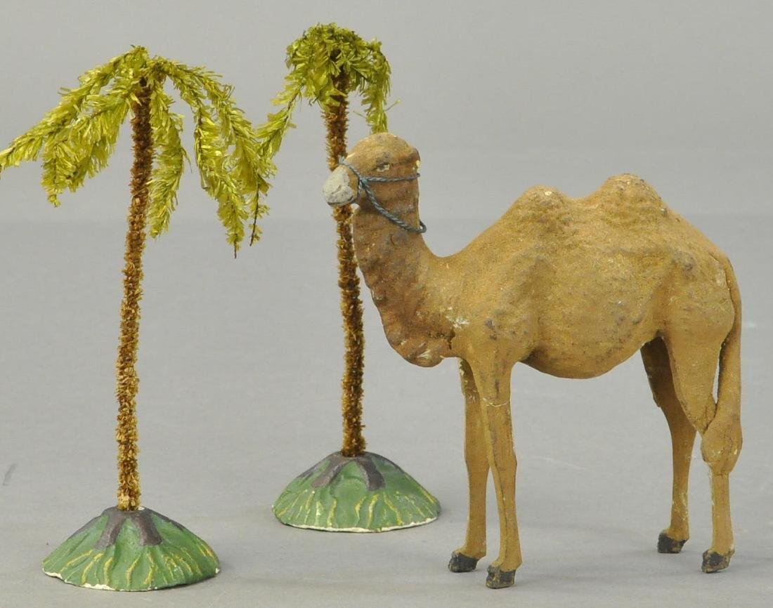 TWO PALM TREE AND A CAMEL