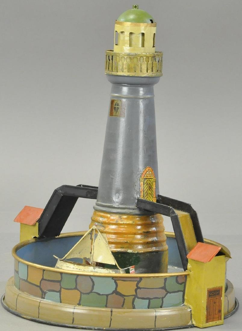 GERMAN SAILBOAT CIRCLING LIGHTHOUSE TOY - 3