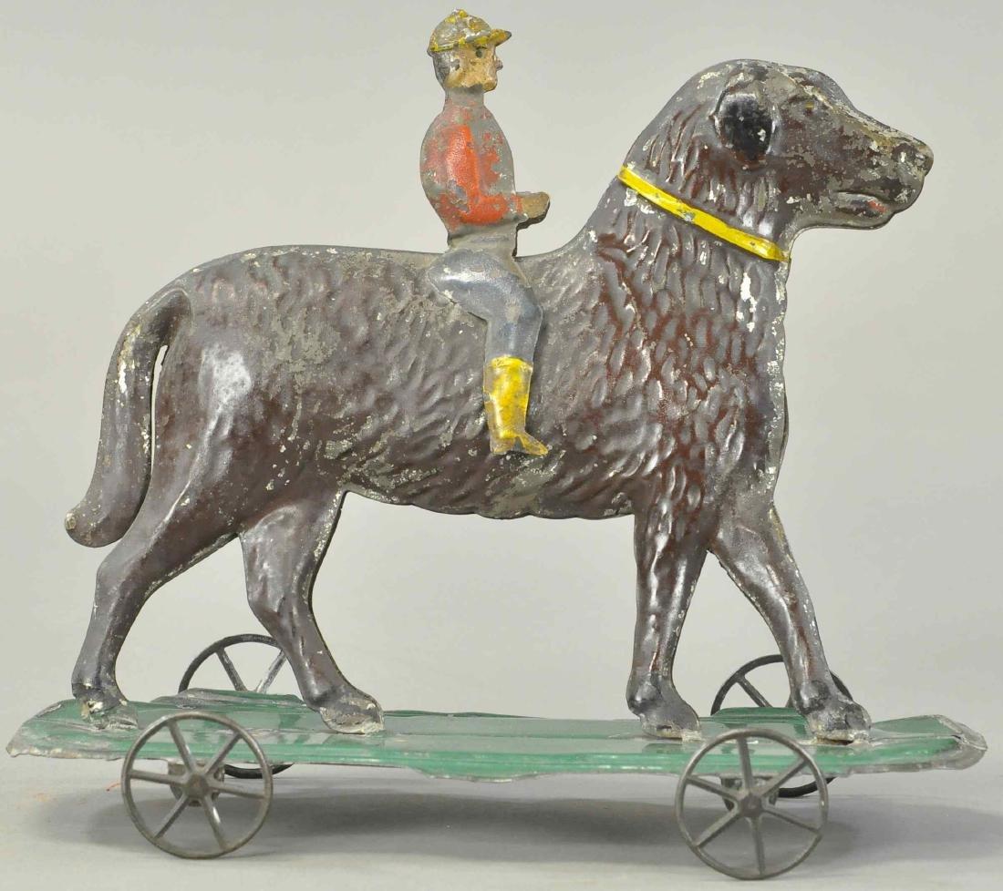 EARLY AMERICAN TIN BOY RIDING HORSE