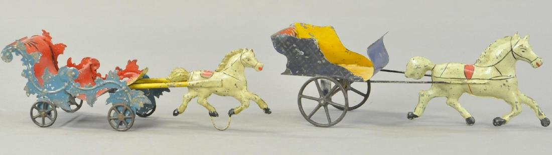 PAIR OF EARLY AMERICAN TIN CARTS