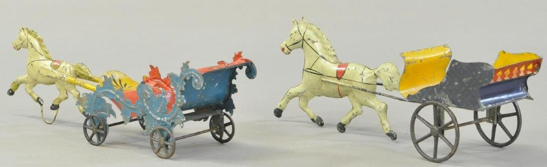 PAIR OF EARLY AMERICAN TIN CARTS - 2