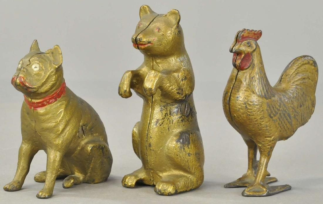 THREE GOLD ANIMAL STILL BANKS