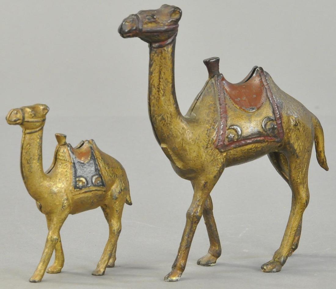 PAIR OF CAMEL STILL BANKS