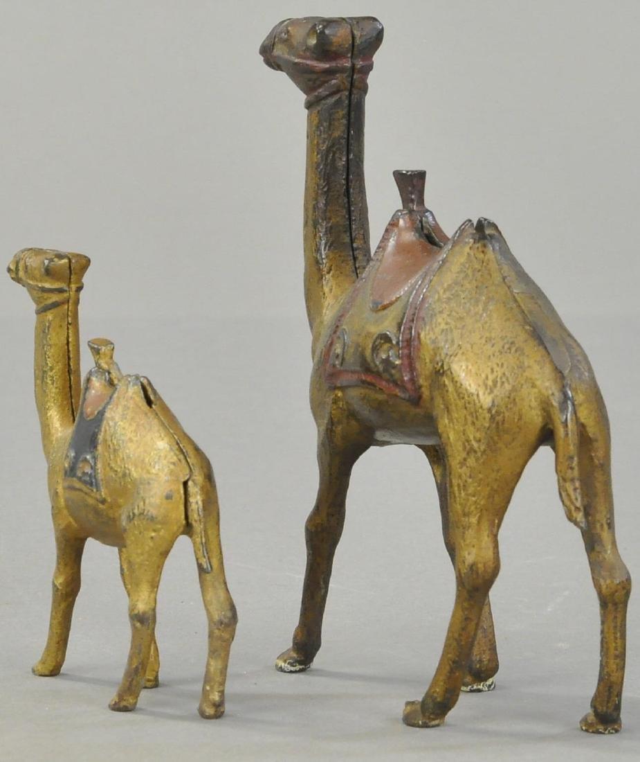 PAIR OF CAMEL STILL BANKS - 2