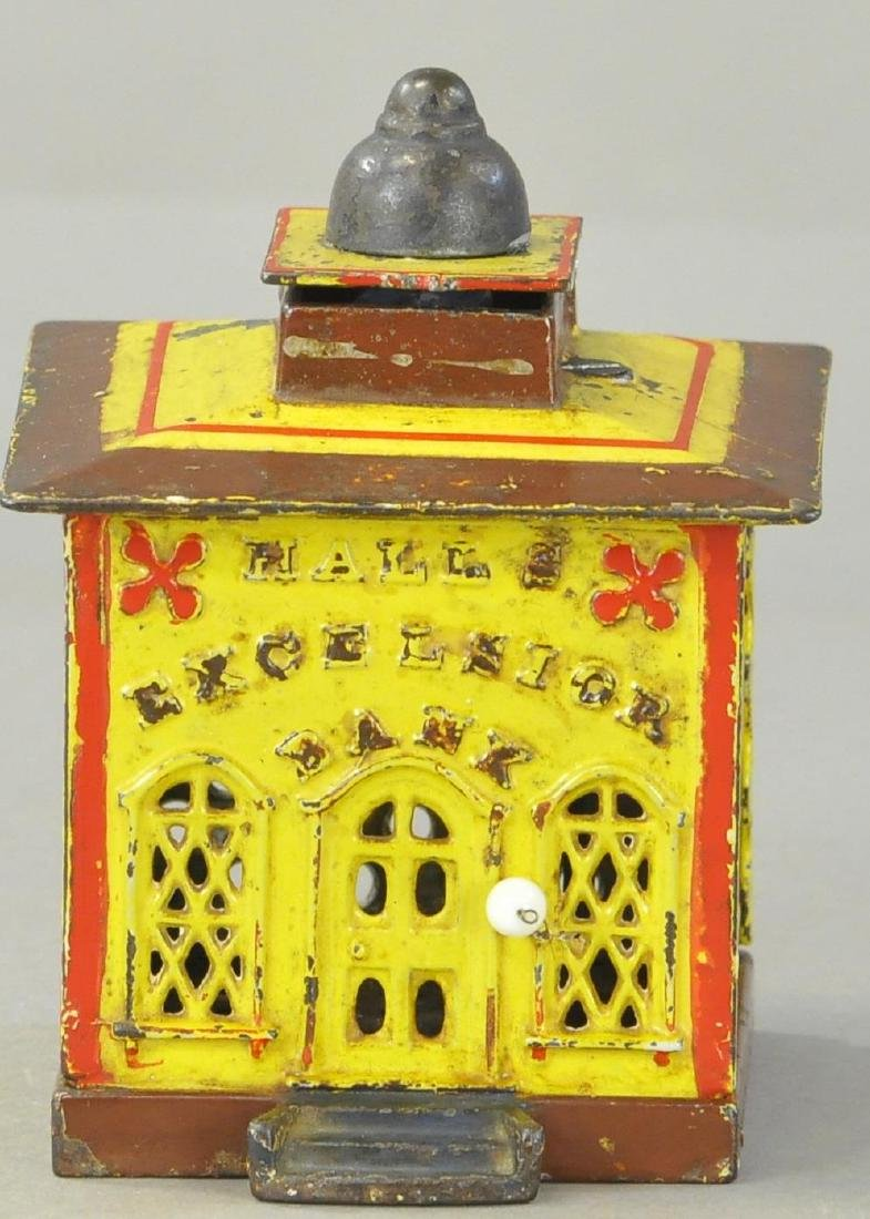 HALLS EXCELSIOR MECHANICAL BANK - YELLOW/RED