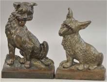 TWO B& H DOG DOORSTOPS